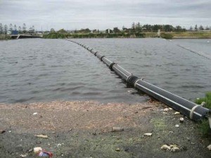Bandalong Boom Systems are installed across waterways, acting as a final barrier to collect or deflect debris.
