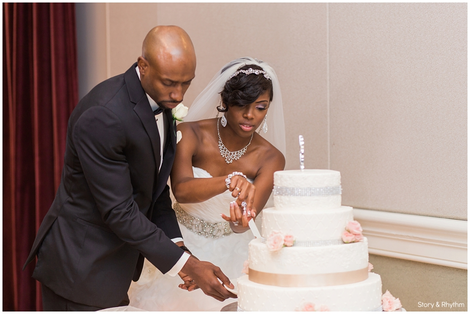 The couple cutting the cake during the reception