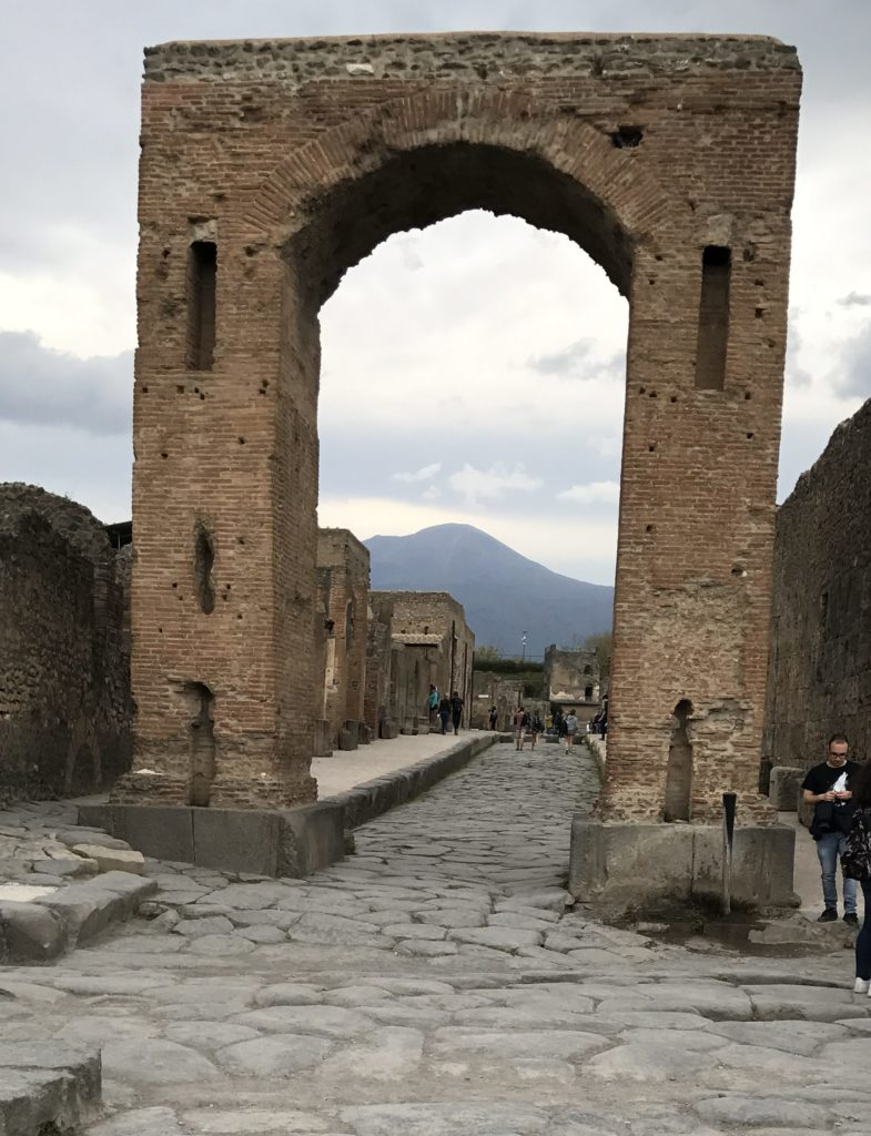 Another gate takes us from the busy markets to the residential areas. What a view of Mount Vesuvius looking over Pompeii.