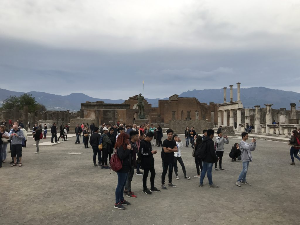 Facing away from Mount Vesuvius, is the city hall which housed the government. The main entrance to the to the forum is on the far right, lined with marble columns.