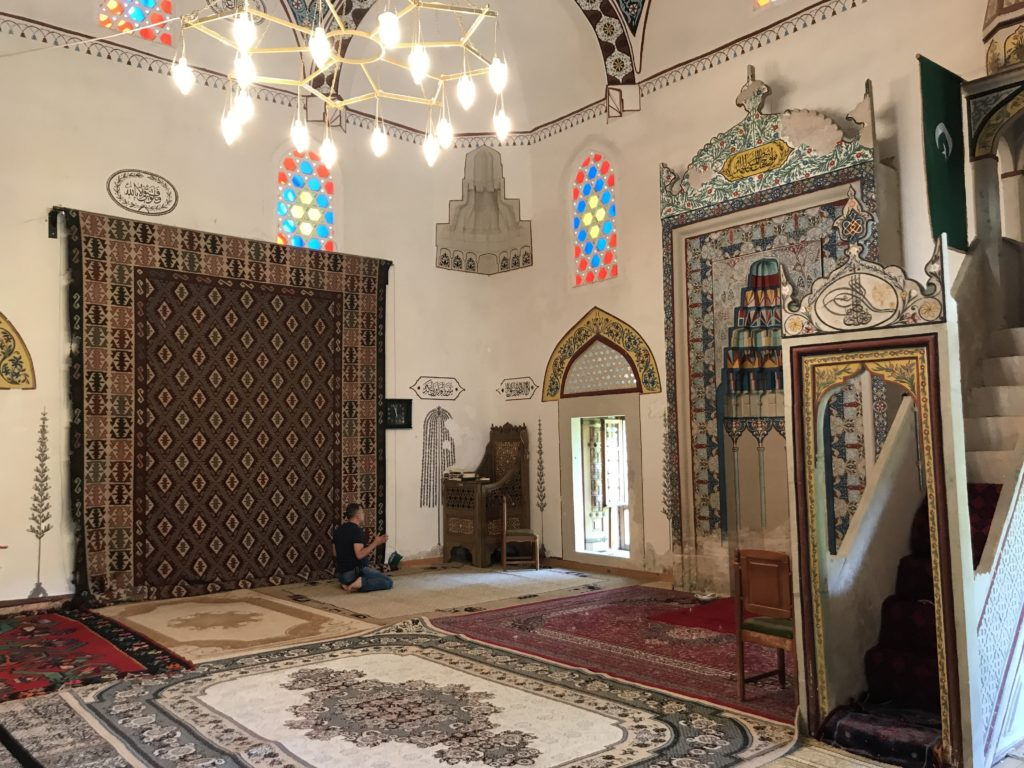 A man worships in this mosque in Mostar.