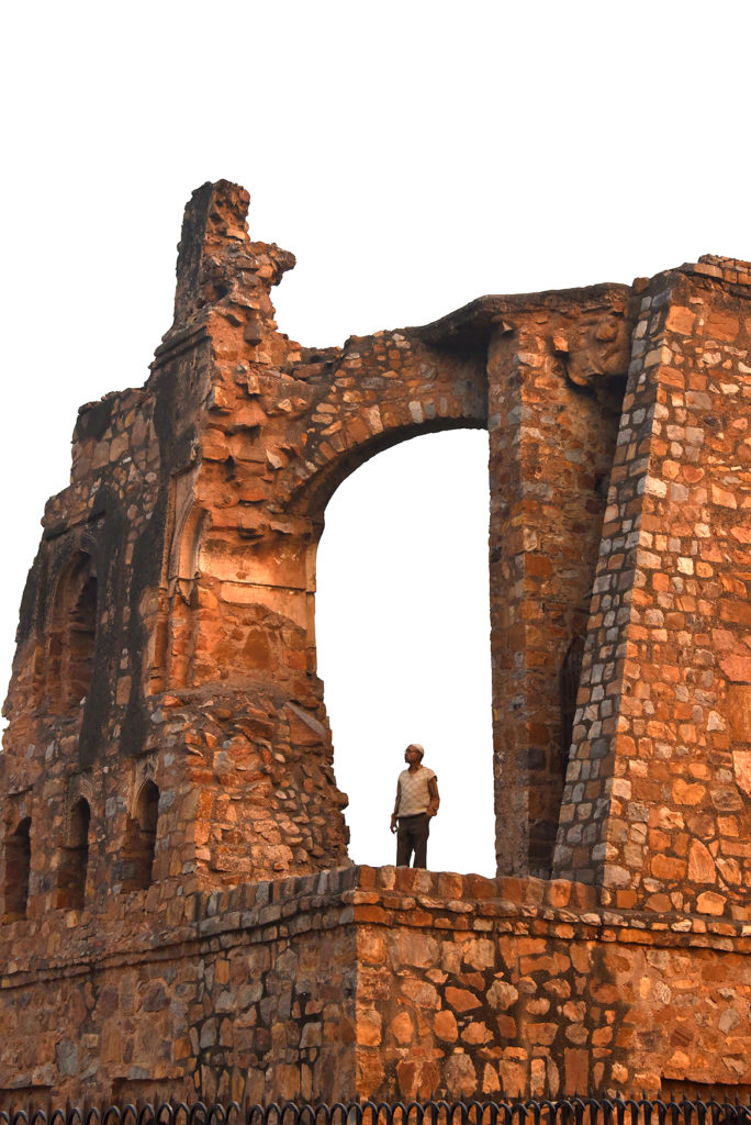 Local man beholding the grandeur of once majestic mosque in Feroz Shah Kotla, Delhi