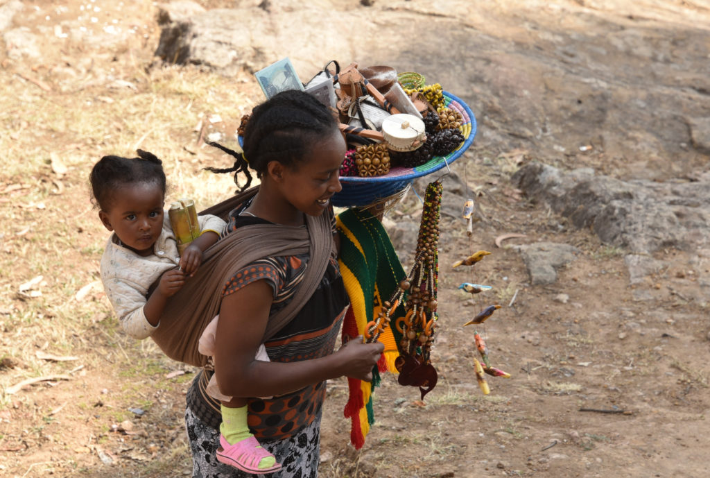 Addis Ababa: A young mother selling handicrafts to visitors atop Mt Entoto