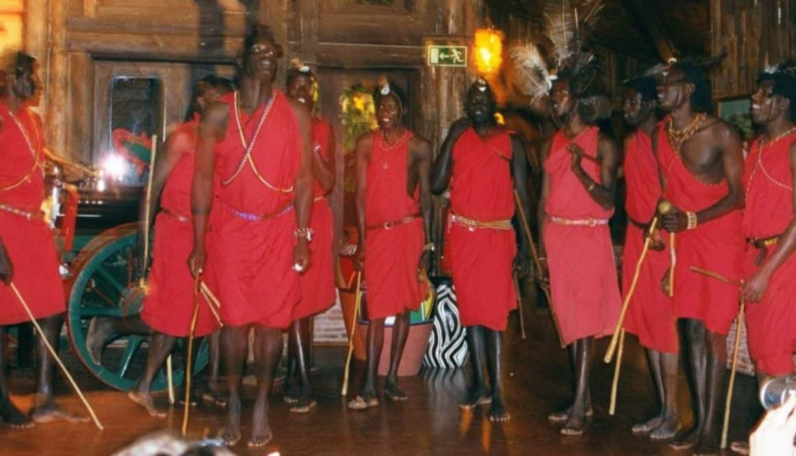 Masai Dancers jump up and down to drum music.