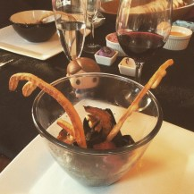 Wee Hannibal eyeing the squid ink pasta with stag antler breadsticks.
