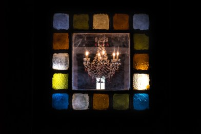 Chandelier and Stained Glass. Image credit: Gary Allman