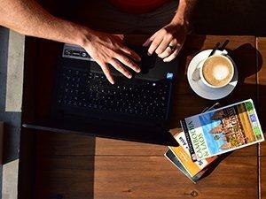 Laptop coffee books birdseye