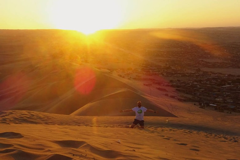 Itinerary for Peru: the oasis village of Huacachina is a great place to catch a stunning desert sunset