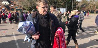 Pictured is Phillip Cooper selling scarves for Shrovetide in Ashbourne. Photo: Tom Morley
