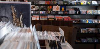 Record store displaying various albums