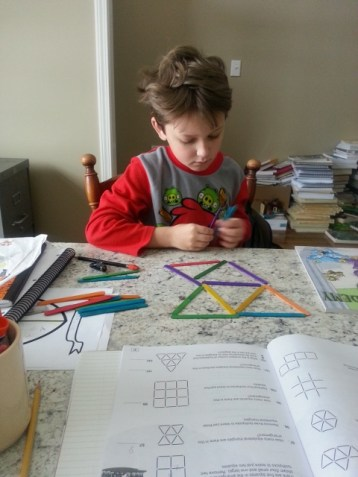 Middle Boy working on math...love his crazy hair