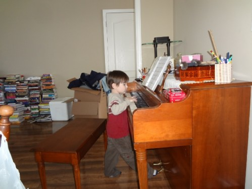 Littlest at the piano