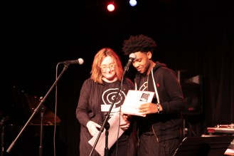 Susan Coangelo persents Taron with the 2016 President's Teen Leadership Award at 2nd Annual Benefit Concert.3.19.2016.Photo by Qingru Chen. c Story Stitchers 2016