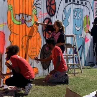 Stitchers Youth Council paints ta mural with artist Katherine Bernhardt