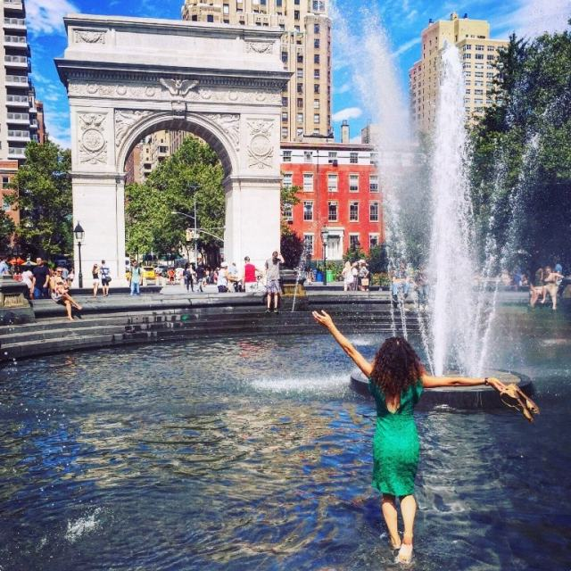 Cooling down in the fountain in Washington Square park while listening to intimate street jazz orchestra - New York travel tips