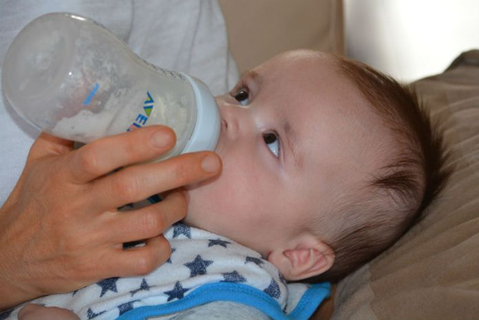 Formula feeding tips: The Ultimate Guide To Surviving A Long Flight With A Baby