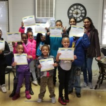 children receiving participation awards from ncwit