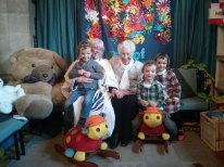 with her beloved grandchildren (triplets)