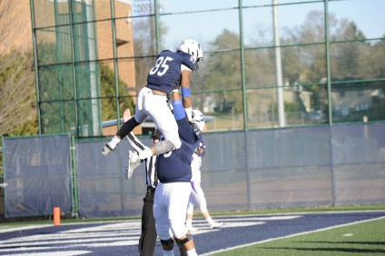 Offensive lineman Kane'ala Atchison-Keolanui (Sr, Lodi, Wis) celebrating with wide receiver Brian Sandifer (Jr, St. Paul, Min) after scoring a touchdown against nationally ranked UW–Whitewater.