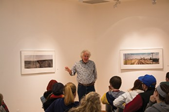 Stuart Klipper gives a talk to locals about his photography, which is currently displayed in the Furlong Gallery.