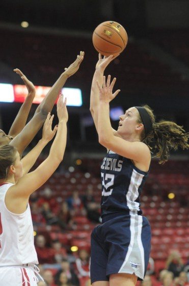 Anna Brown (Jr, Wausau, Wis) goes up for a jump shot during a game against the Wisconsin Badgers.