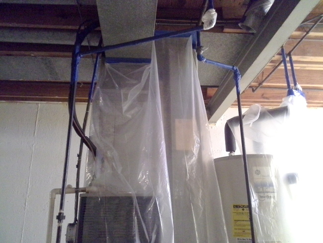 prepping-for-basement-painting-with-paint-sprayer