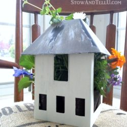Turn a miniature house or birdhouse into a planter. This one was a tealight holder, so it had an open area where plants could be tucked into - repurposed-birdhouse-tealight-planter - StowAndTellU.com