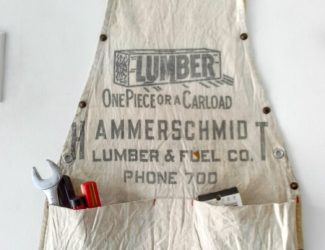 Vintage work apron hanging storage - StowandTellU.com