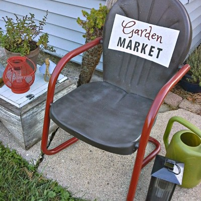 Vintage Metal Chair with Painted Sign