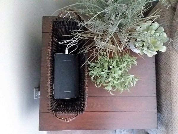 Tablet charging in basket on table top