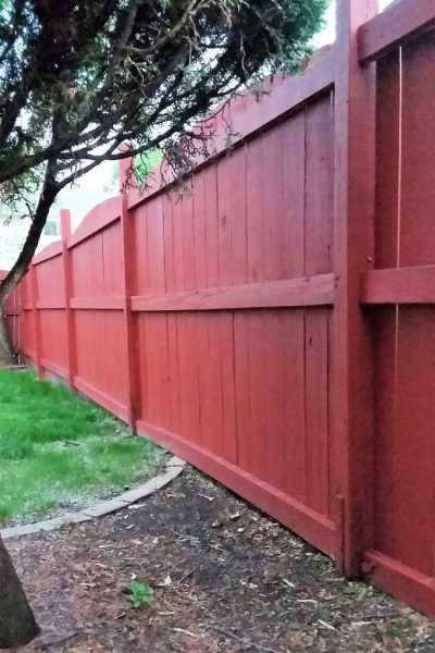 Straight tall Navajo Red Painted Fence