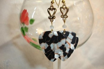 Guitar pick earrings and painted glass goblet, designed by Debra Moore