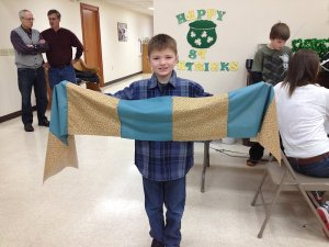 Dylan shows off his quilt strip
