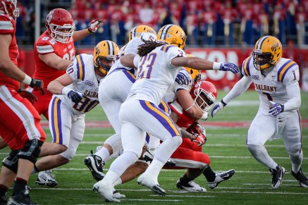 University at Albany Great Danes inside linebacker Mat LaDucer takes down Stony Brook University Seawolves running back James Kenner with less than three minutes remaining in the fourth quarter in a game on Saturday, Nov. 23, 2013 at Stony Brook University's Kenneth P. LaValle Stadium. Stony Brook beat Albany 24-3. Photo by Wasim Ahmad.