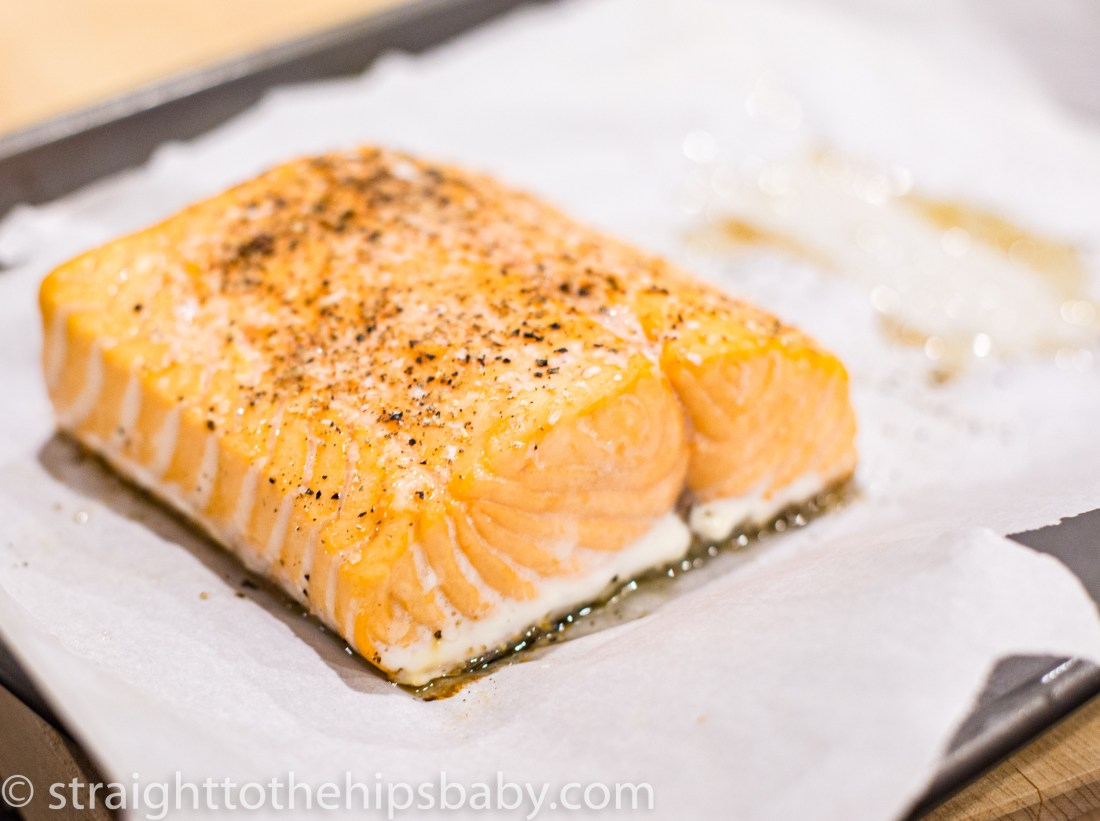a cooked salmon filet, crusted with salt and pepper