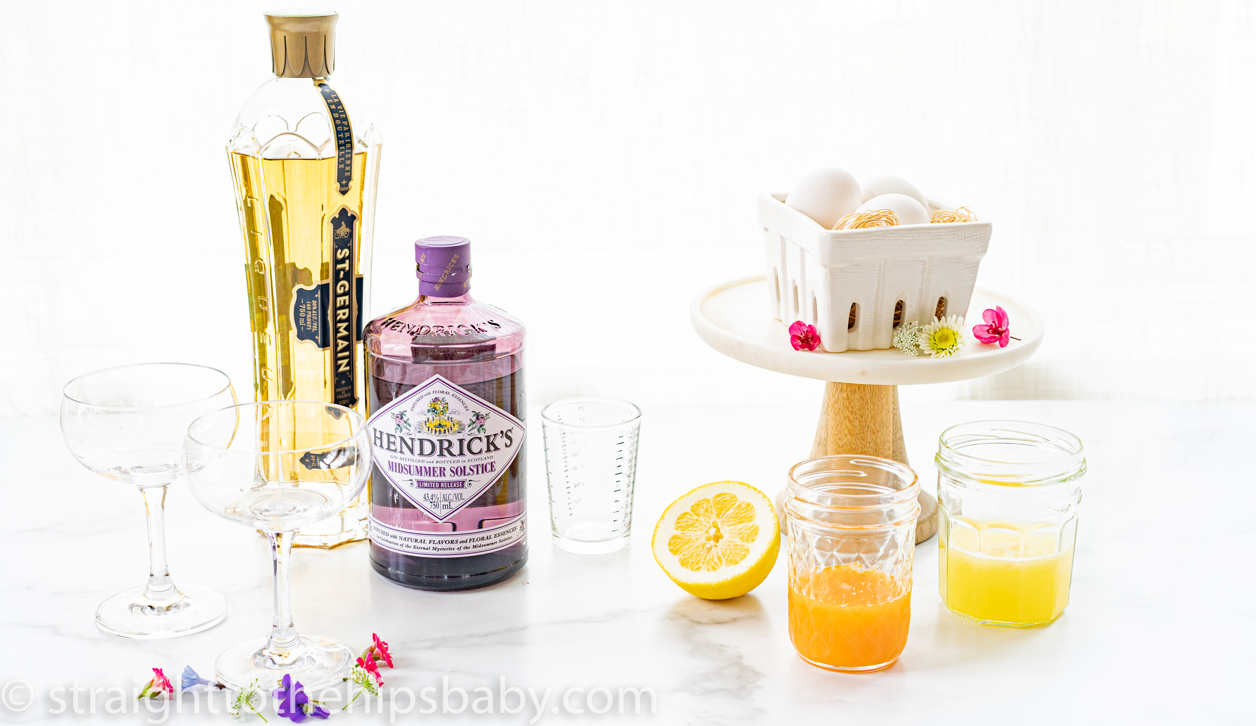 ingredients flat lay including Hendrick's gin, Dt Germain, and fresh citrus