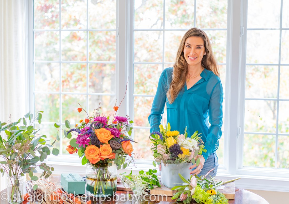 model-esque fashion blogger, Jaimie Tucker, standing with completed bouquets