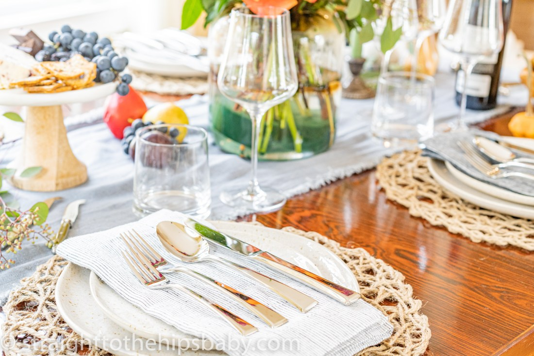 a polished silver place setting