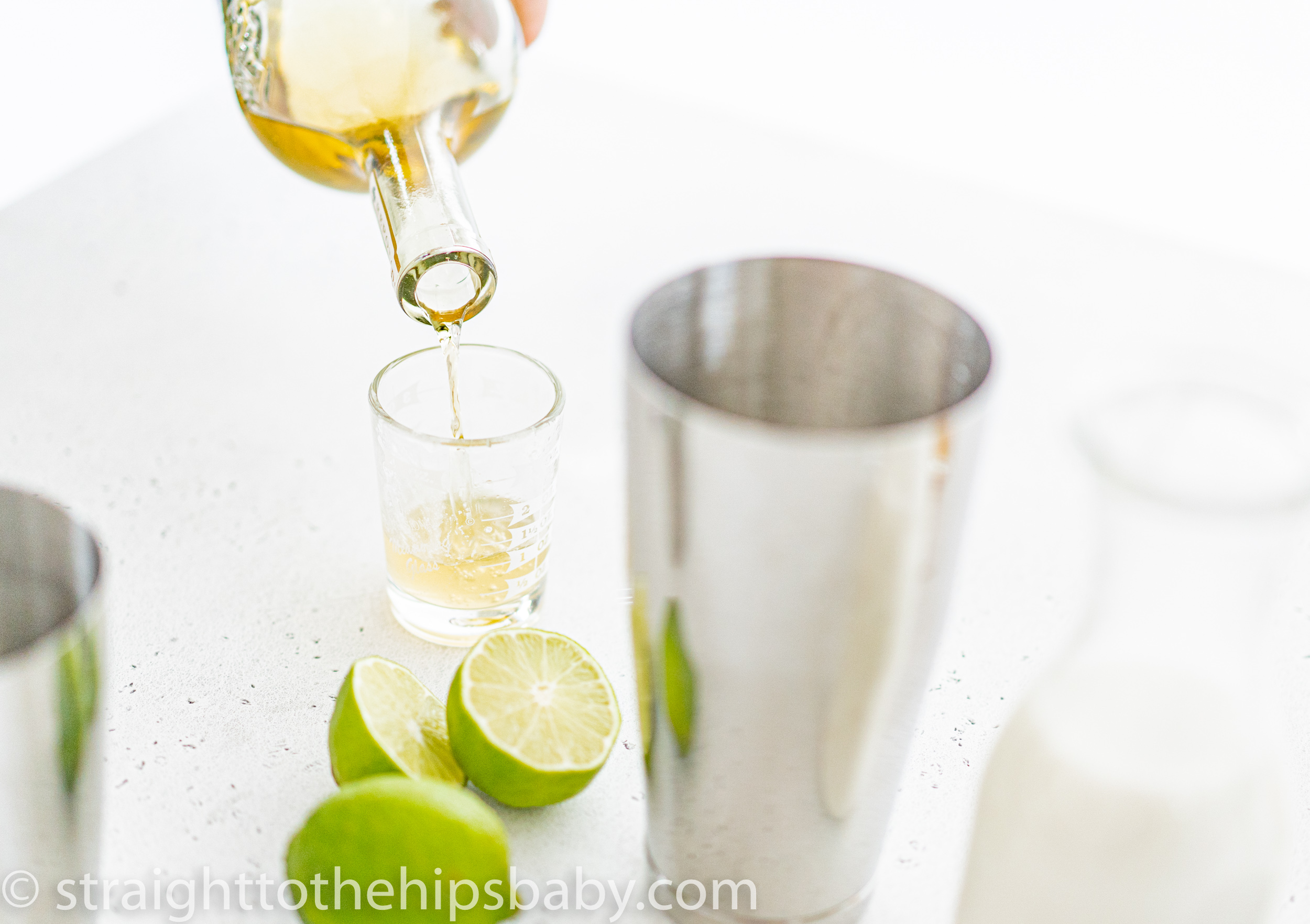 pouring tequila into a jigger