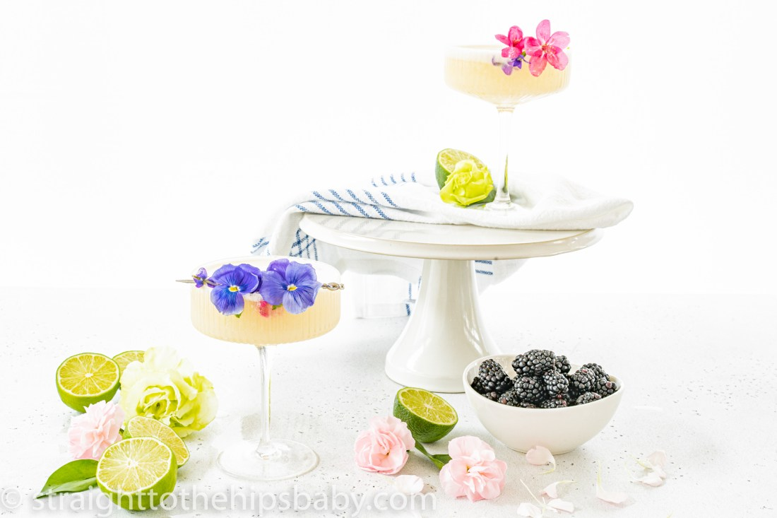 2 coupe cocktail glasses filled with the Creamy Coconut Pearl Paloma