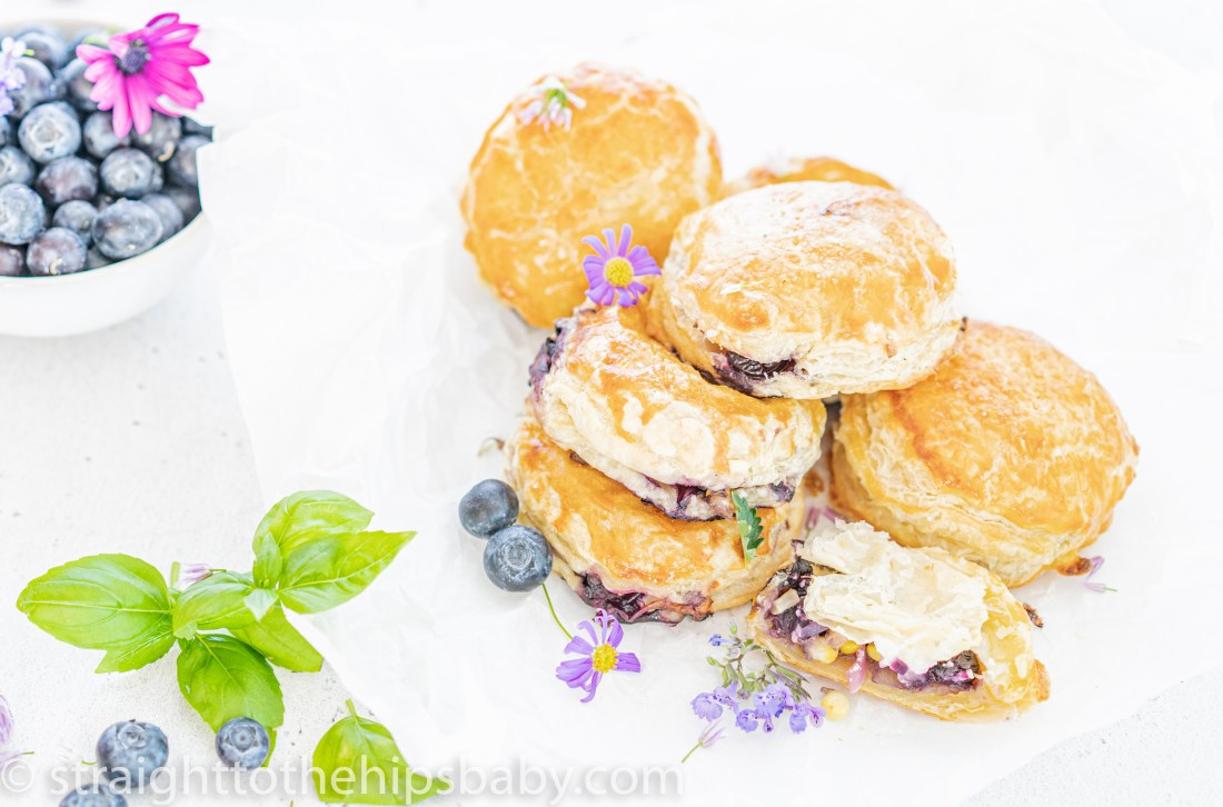 finished blueberry & goat cheese puff pastry puffs on a white background