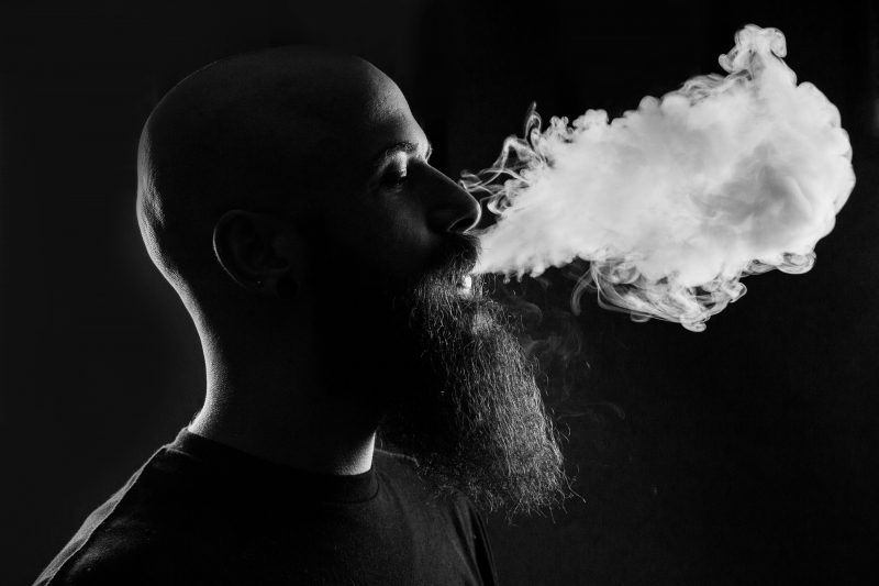 a man using vape because of the link between cannabis and DNA