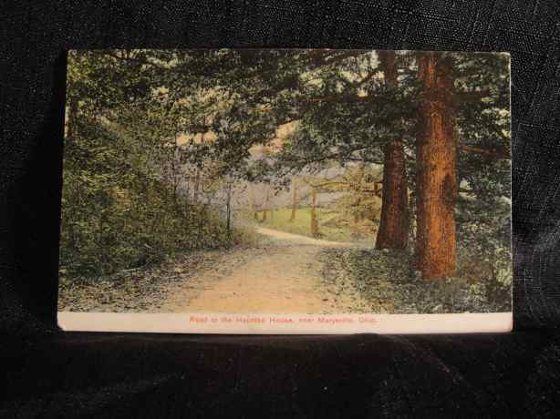 road to haunted house postcard
