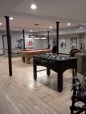 The Man Cave, complete with a full kitchen, theater, Foosball, ping pong, and pool.