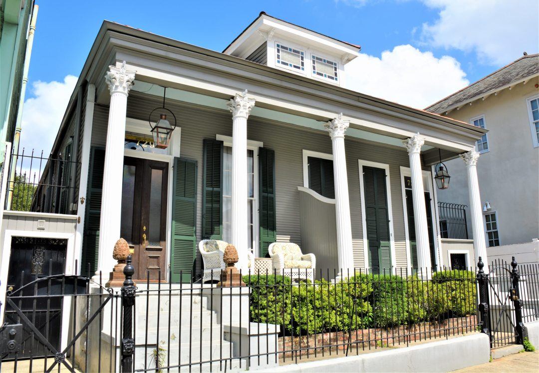 Double shotgun in New Orleans with Greek Revival accents
