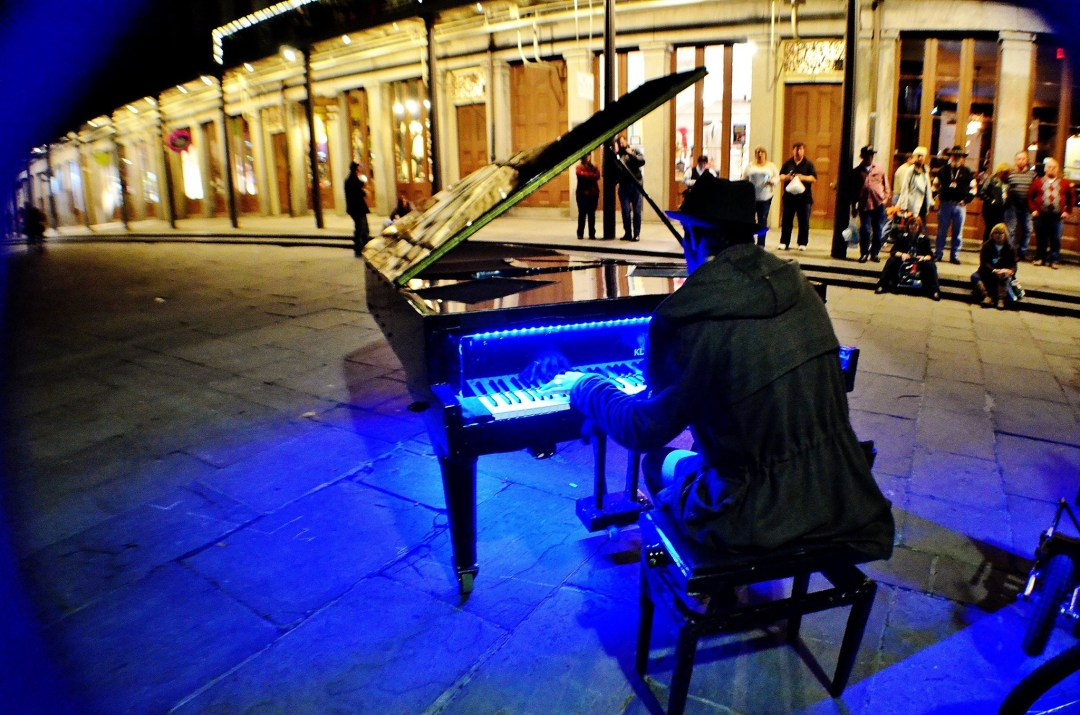 Pianist plays at night in the French Quarter of New Orleans