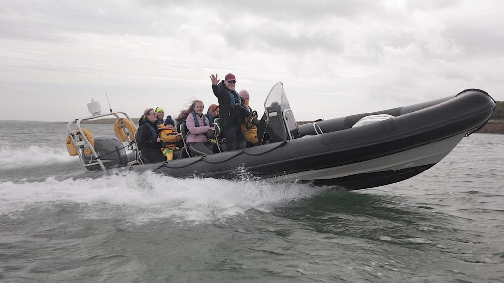 RIB speeding across the Lough
