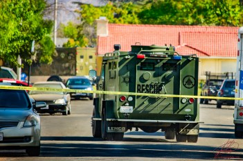SWAT vehicles leave the scene.