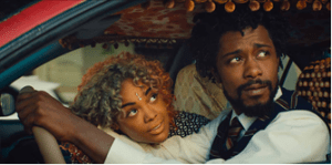 Source: NY Review of Books | Detroit (Tessa Thompson) & Cassius Green (LaKeith Stanfield) in Sorry To Bother You (2018)