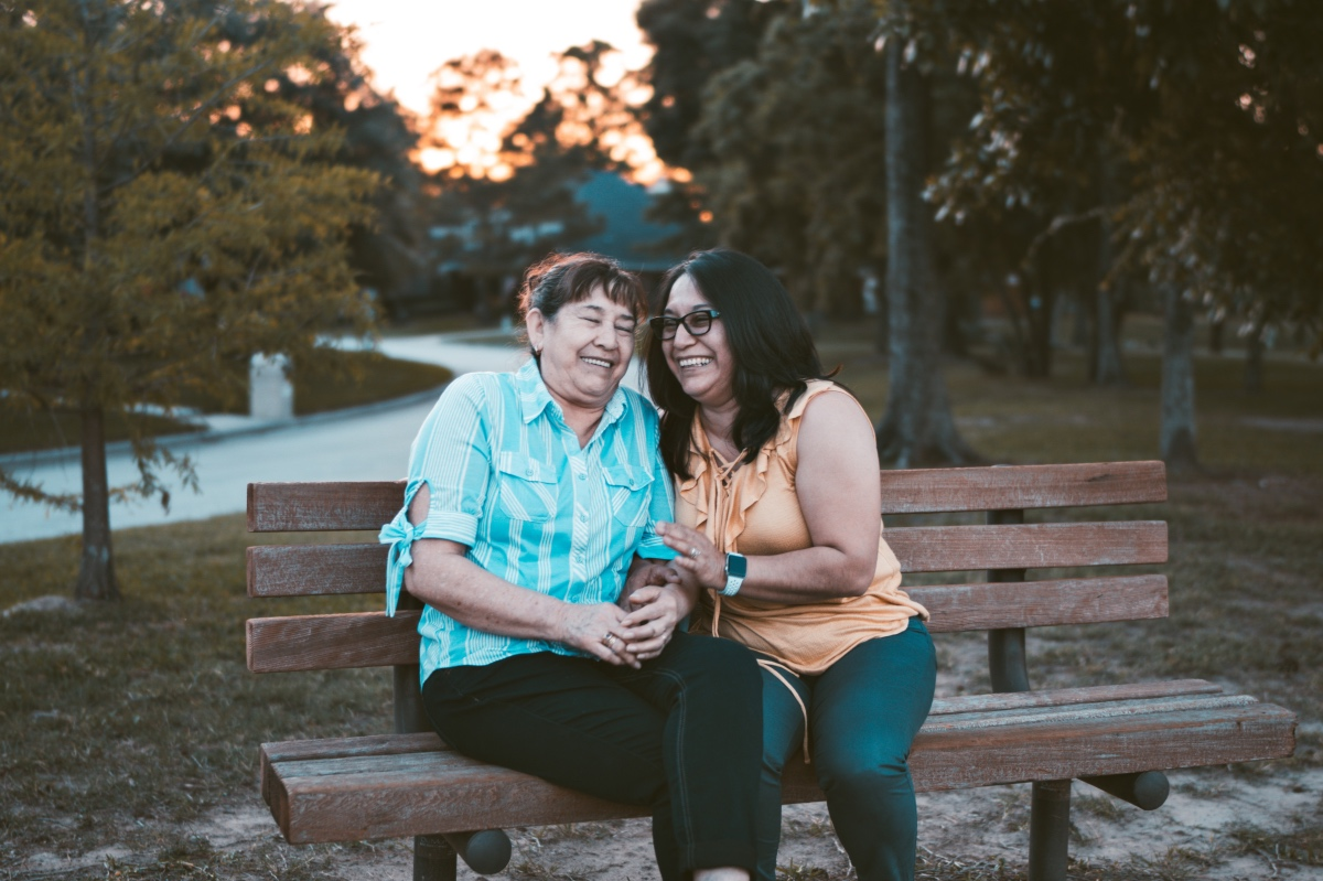 Points-To-Discuss-With-Your-Aging-Parent-Women-Sitting-On-Bench-With-Mom